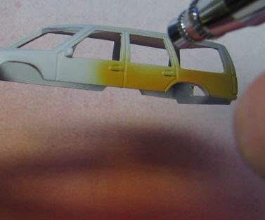 tools and supplies for painting a hot wheels casting